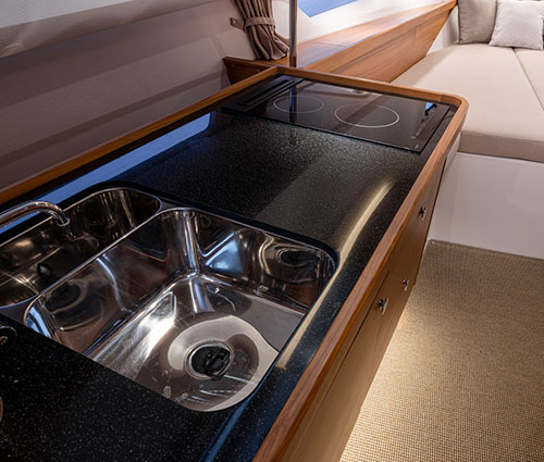 Interior Galley with cooktop sink cooktop and refridgerator